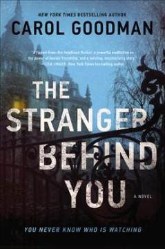 The stranger behind you : a novel by Goodman, Carol.